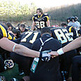 Cardwell leads the team in prayer..